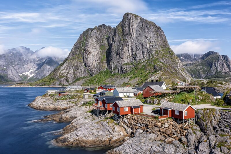 A sunny day in Hamnoy, a traditional Lofoten fishing village on the island Moskenes, Lofoten island, Norway. Long exposure shot.