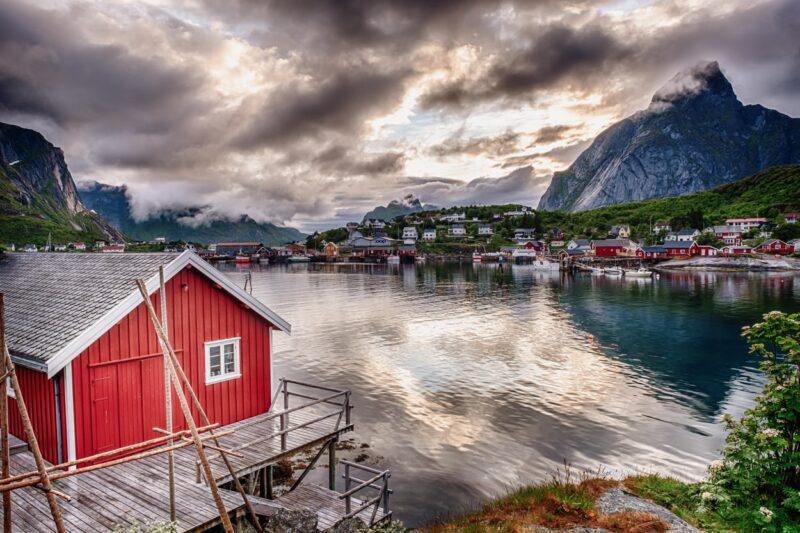 Arctic summer, midnight thunderclouds in Reine, Lofoten Islands, Norway.