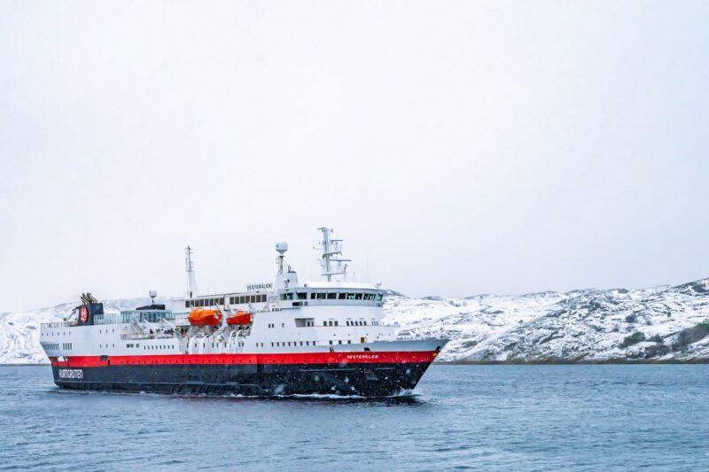 It is snowing when the MS Vesterålen from Hurtigruten arrives in Bodø, Norway.